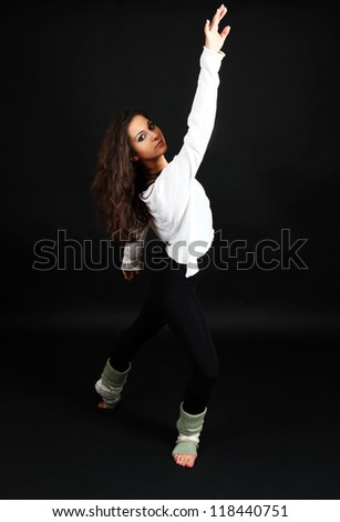 young modern dancer  posing, isolated on black