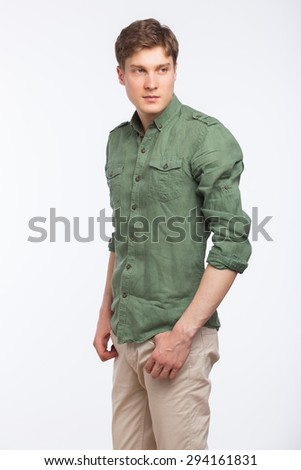 young modern man cool dressed with green shirt standing, isolated on white - stock photo