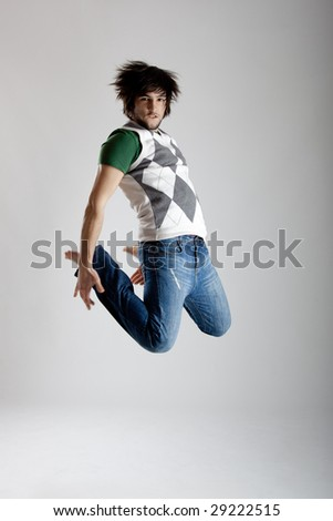 Young modern man dancing over a white background - stock photo