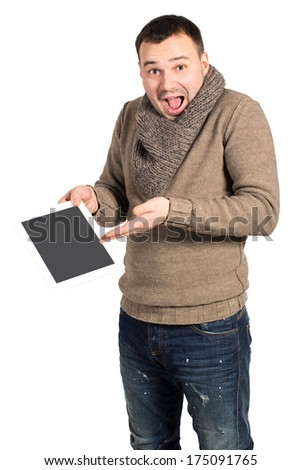 Young modern man presenting his new and cool tablet pad. Isolated on white background. Emotional man shows what pure electronic tablet. The man with the emotion of surprise or delight on her face. - stock photo
