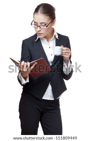 young modern professional businesswoman holding diary and cup of coffee - stock photo