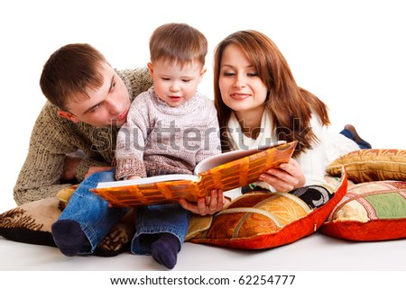 Young mom and dad reading for the kid