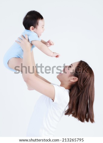 Young mom and son smile happily isolated