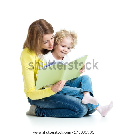young mom reading a book to her child - stock photo