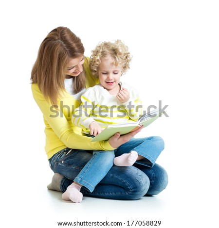 young mom reading a book to her kid - stock photo