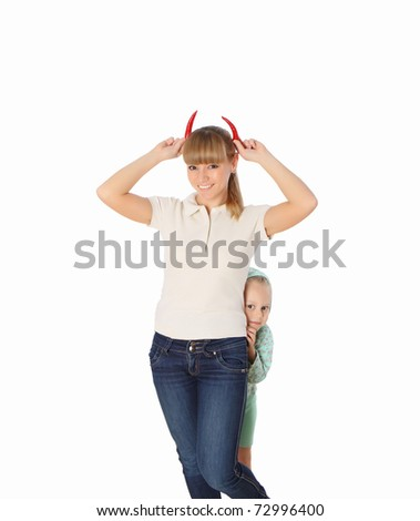 Young mom with horns of red chili peppers - stock photo