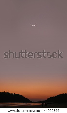 Young Moon at sunset in India - Goa - Palolem beach - stock photo