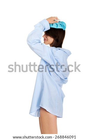 Young morning woman in big shirt with headache. - stock photo