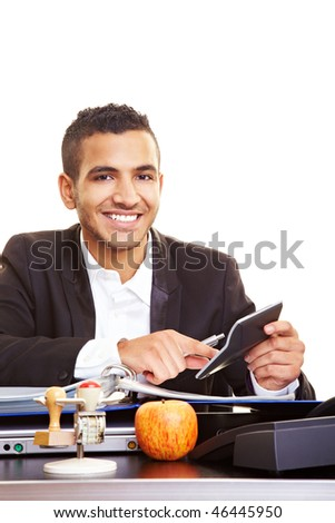 Young moroccan manager using a calculator