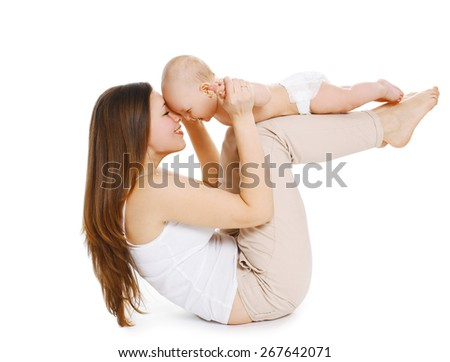 Young mother and baby are doing exercise and having fun on a white background - stock photo