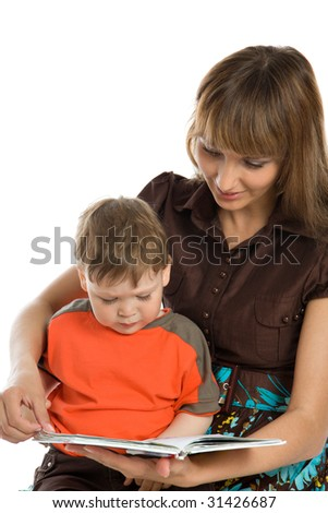 Young mother and baby reading book - stock photo