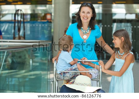 Young mother and child in the airport