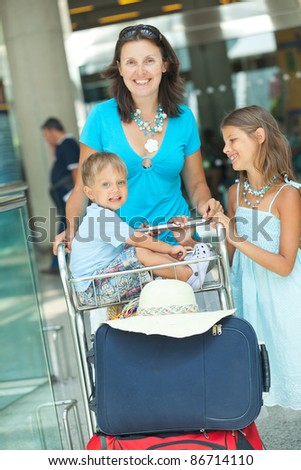 Young mother and child in the airport - stock photo