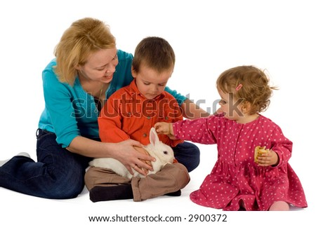 Young mother and children with a bunny (easter theme, isolated) - stock photo