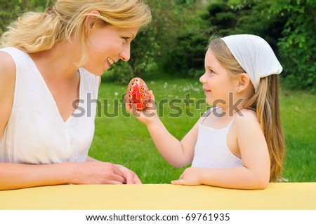 Young mother and daughter having Easter time - stock photo
