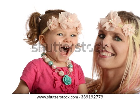 Young mother and daughter having fun isolated on a white background - stock photo