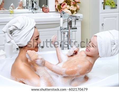 Young mother and daughter in a bathroom playing happy smiling hugging  taking bath with foam. Bath Stock Images  Royalty Free Images   Vectors   Shutterstock