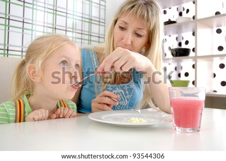 Young mother and daughter in cafe - stock photo