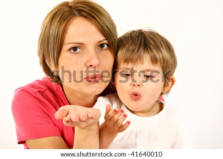 young mother and daughter over white sending kisses - stock photo