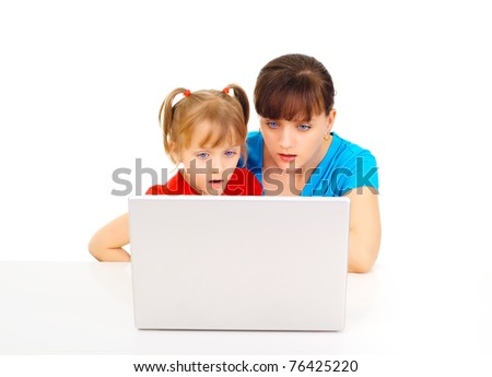 Young mother and daughter shopping online - stock photo