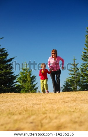 young mother and doughter recreating in nature - stock photo