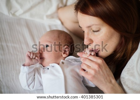 young mother and her baby - stock photo