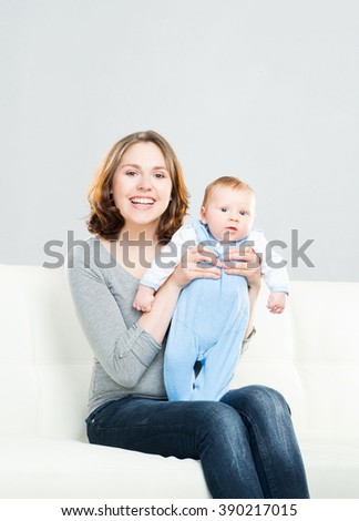 Young mother and her baby child. Infant son and his mom. - stock photo