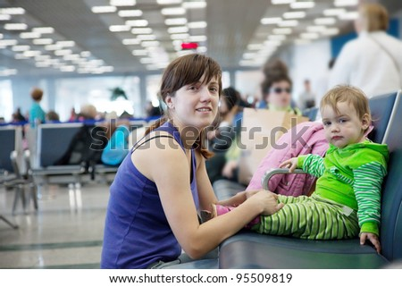 Young mother and her child at airport