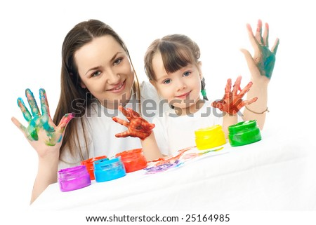 young mother and her daughter painting with finger paints and showing us their  fingers