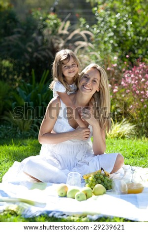 Young Mother and  her daugther Outdoors having fun