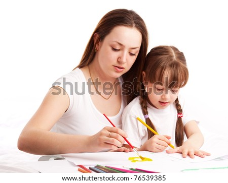 young mother and her five year old daughter drawing with pencils and watercolor at home - stock photo