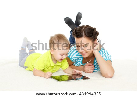 Young mother and her little son with computer tablet lie on a white background. Happy family.