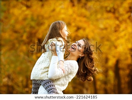Young mother and her toddler girl have fun - stock photo