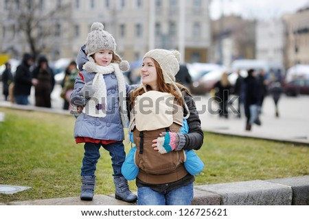Young mother and her two children at spring - stock photo