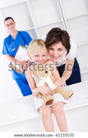 young mother and little girl in doctor's office - stock photo