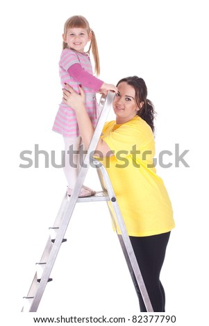 young mother and little girl with ladder - stock photo