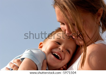 Young mother and son having fun together - stock photo