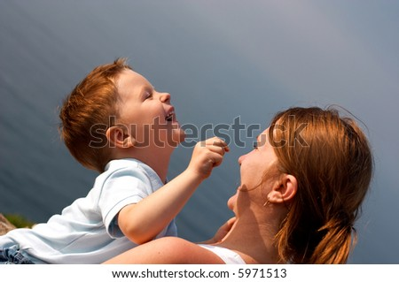 Young mother and son having fun together