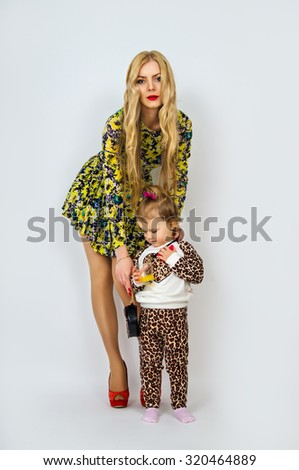 Young mother and the child standing - stock photo