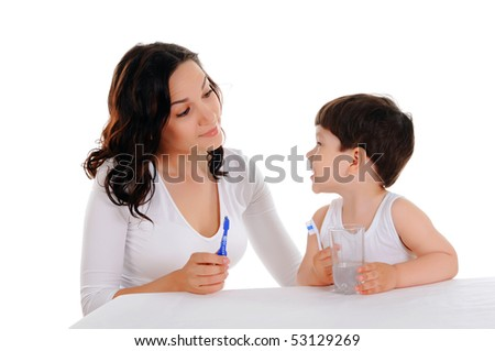 young mother and the little boy brushing teeth - stock photo