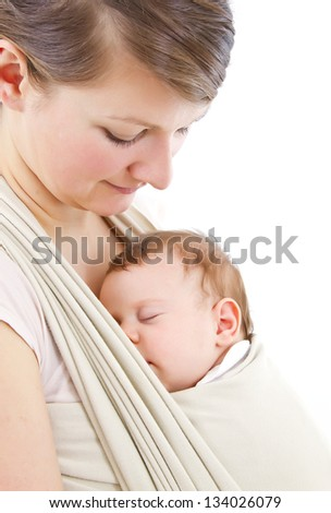 young mother carrying a  newborn sleepimg  baby - stock photo