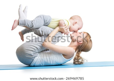 young mother does fitness exercises together with kid boy isolated - stock photo
