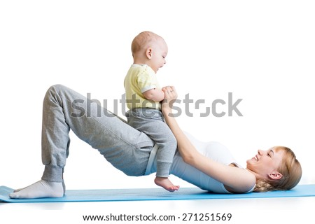 young mother doing fitness exercises together with baby boy - stock photo