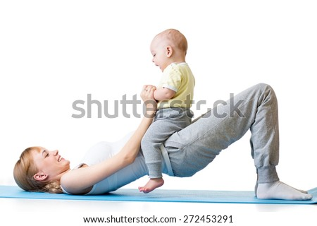 young mother doing fitness exercises together with son baby