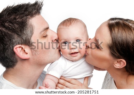 Young Mother Father Kissing Baby. Studio shot on white background.. - stock photo