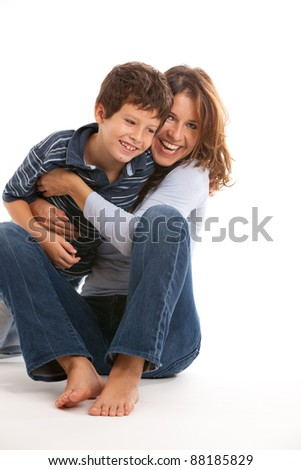 Young mother having fun tickling son isolated on a white background. - stock photo