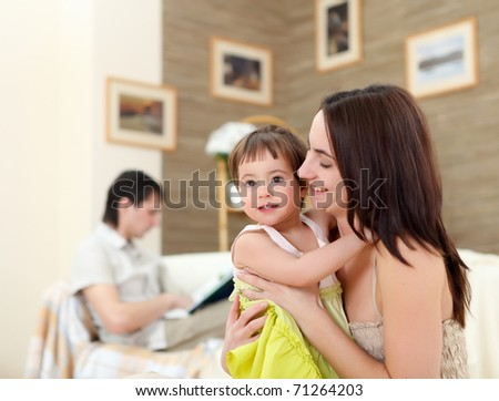 young mother having fun with her little son at home on the floor - stock photo