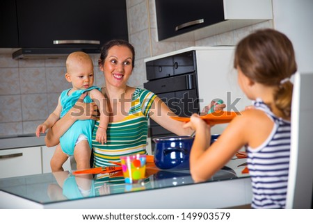 young mother having lunch with their children