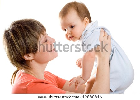Young mother hold  his baby in hands and smile to him