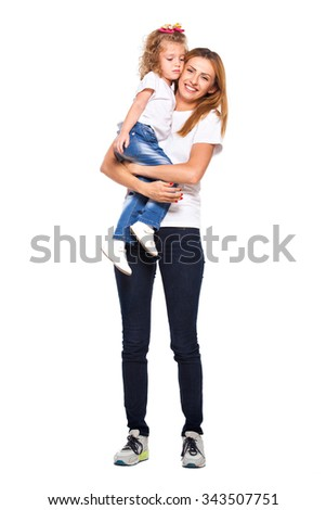 young mother holds her daughter in her arms with love, smiling, isolated on white - stock photo